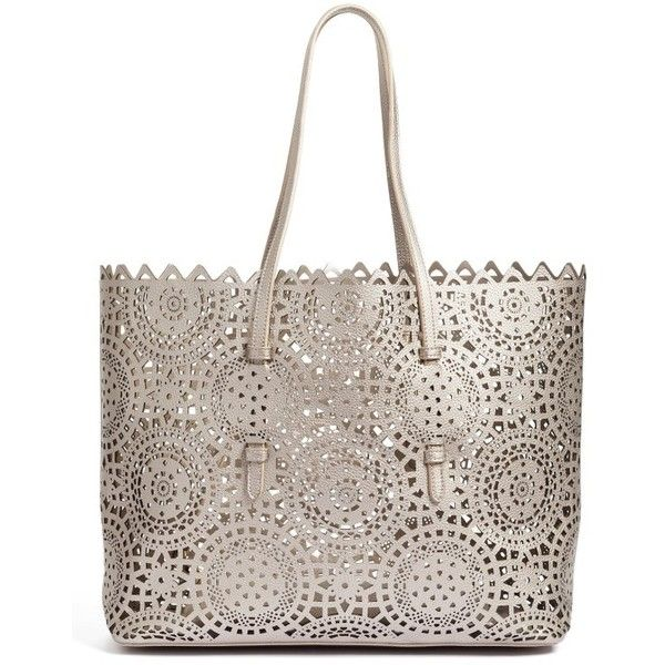 Modern style meets classic practicality with this versatile tote in smooth faux leather detailed with ornate laser-cut perforations.  With a spacious interior …