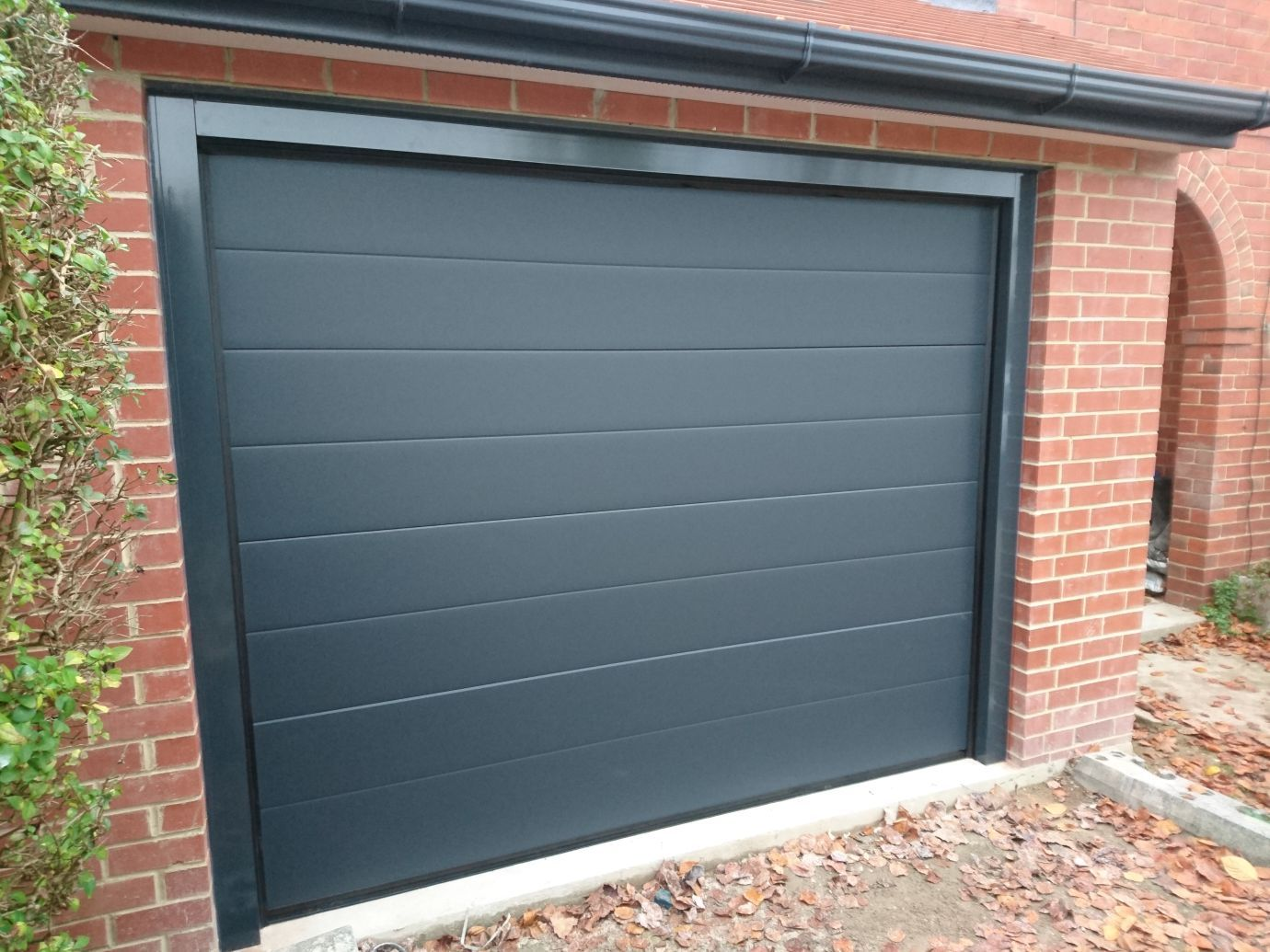 Automatic Sectional Garage Door Finished In Anthracite With The New Executive Frame Making It A Smart Finish Sectional Garage Doors Garage Doors Doors