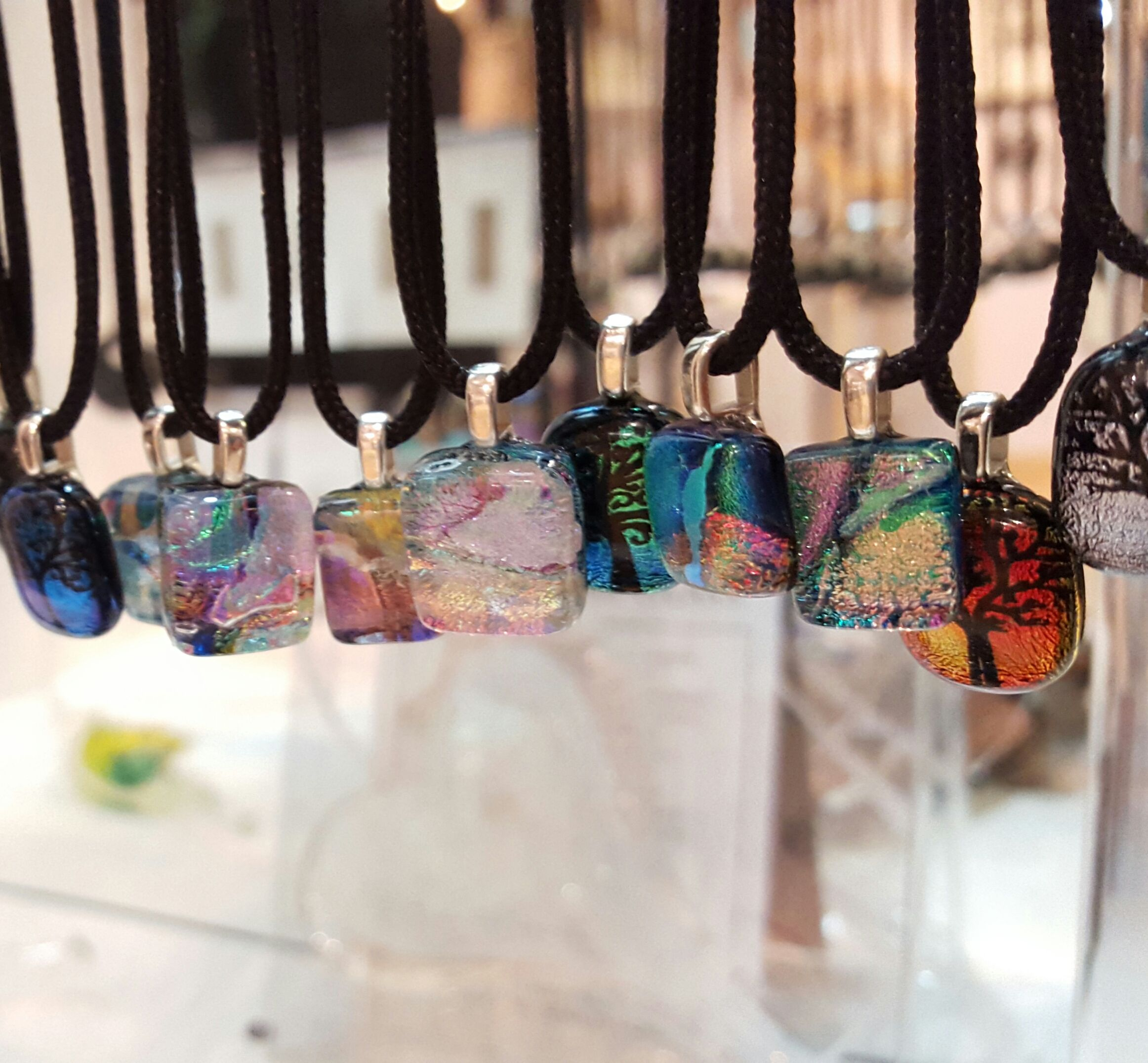 Sometimes fashionistas start young. For the young lady who knows style, we have small dichroic necklaces ($22) and stud earrings ($14) perfect to accent any outfit.