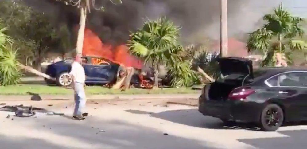 Tesla driver dies in burning car after crash, witness says
