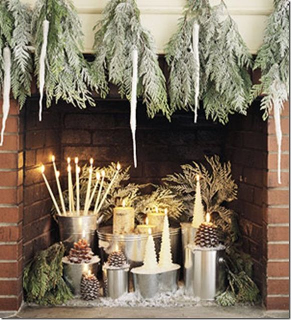 A Holiday Fireplace::I love how they have lightened up the red brick by using 'frosted' greenery and white decorations and adding candles for the element of 'fire'. They have a sort of 'Fire and Ice' theme going here, and I really like that.