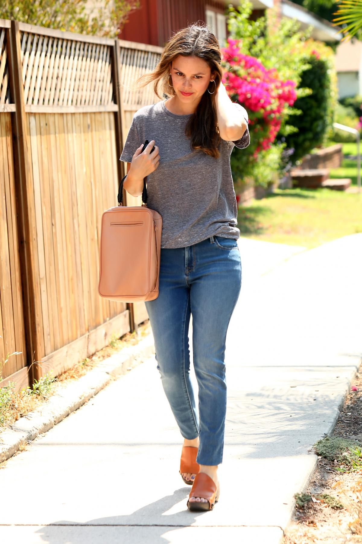 Rachel Bilson wearing Rachel Comey Olten Box Bag in Clay and Old Navy Mid-Rise Rock Star Jeans in Henry