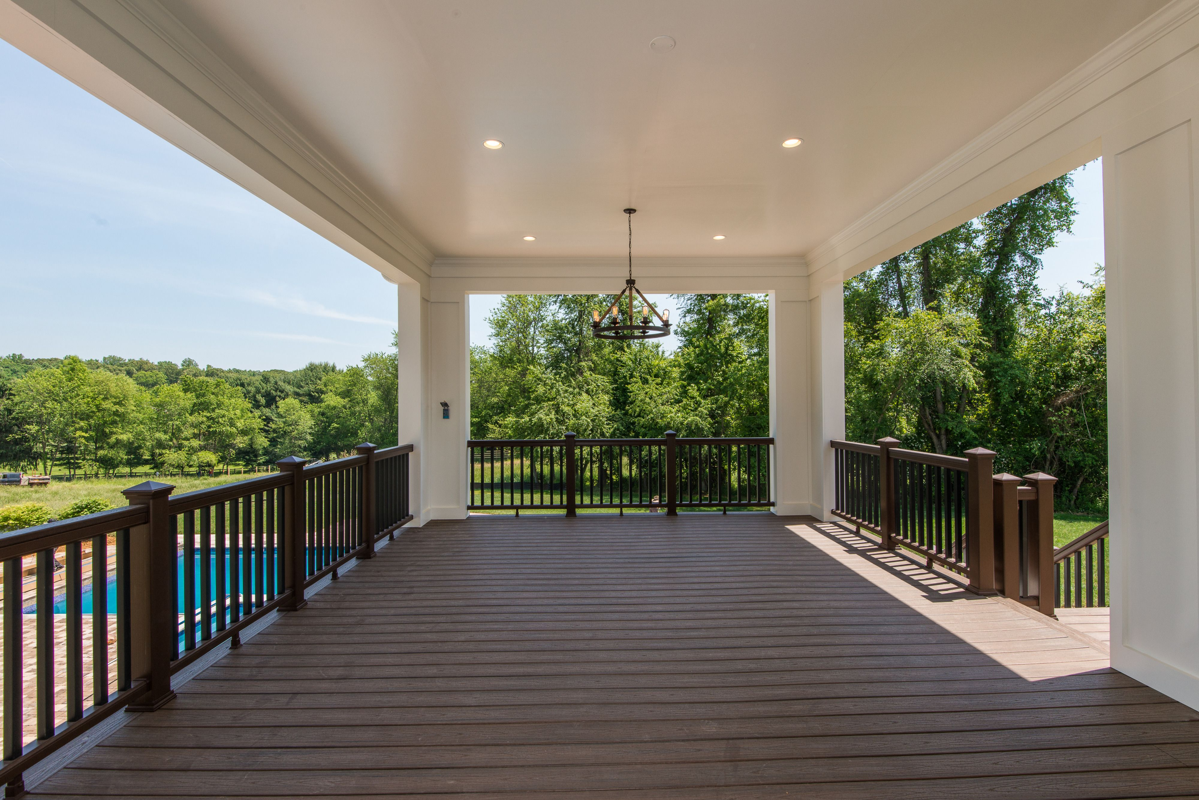 Covered outdoor living room overlooking the pool terrace. Gulick ...
