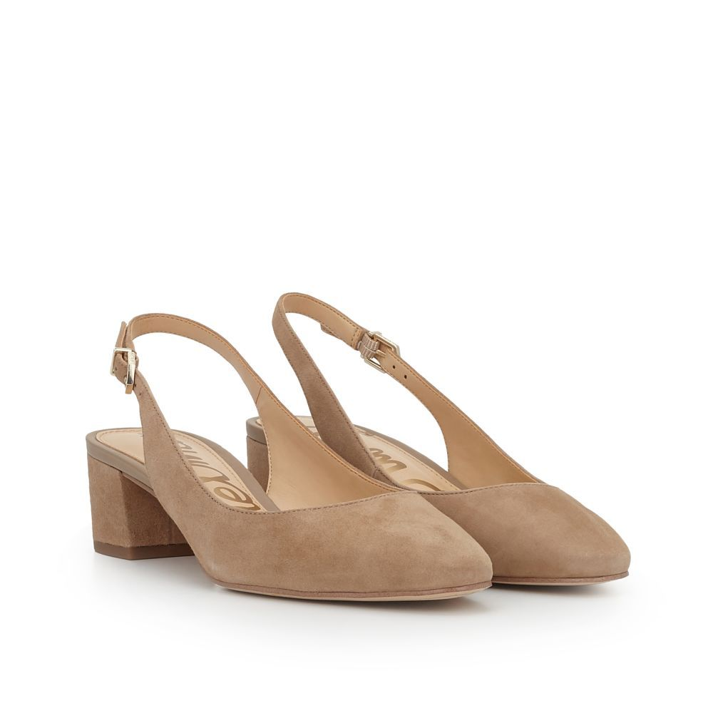 63b6b7d4846 The Lorene Slingback Block Heel is ravishingly retro. This model is rife  with fifties and sixties swagger