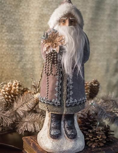 Gray Suit Santa With Poinsettia  A golden poinsettia sparkles, radianting winter's beauty in the hands of Santa Claus.