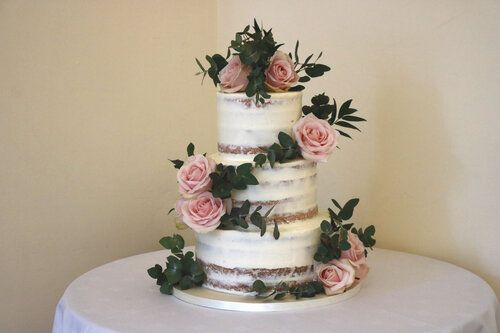 Semi naked cake with pink roses and eucalyptus in Pembroke Lodge, Richmond Park, west London #wedding #weddingcake #Weddingplanning #weddinginspiration #cakes #syonwedding #londonwedding #londonbride #londoncake #sugarflowers #rose #peony #eucalpytus  #seminaked #nearlynaked #seminakedweddingcake #buttercreamweddingcake