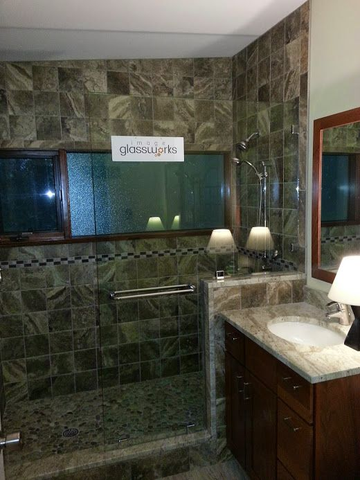 A frameless splash guard panel that was notched to go over the ...