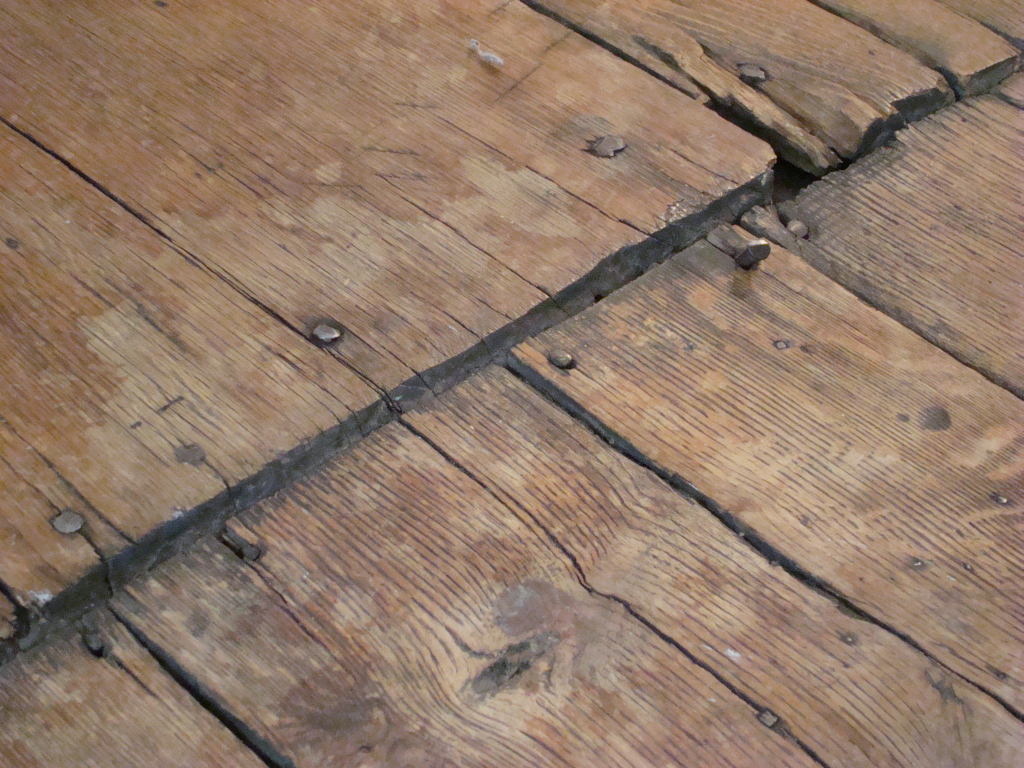 Historic Wood Floor And Iron Nails In