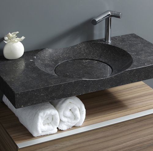 way too cool sink / countertop.  love negative space below for towel storage