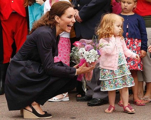 Canada Day 6: The Duchess laughs after she had to coax flowers from Alexa Currie during a visit to Summerside, Prince Edward Island #katemiddleton