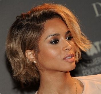 Sport a pixie or bob with a chic side part for a sideswept bang effect. If your short hair is long enough on the sides style it like Ciara with side part and hair tucked behind one ear.