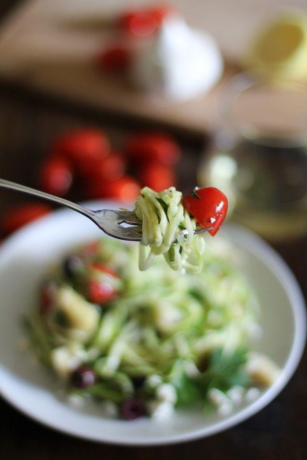 Mediterranean Zucchini Noodle Pasta with cherry tomatoes, artichoke hearts, kalamata olives, feta cheese and garlic-lemon sauce #glutenfree #vegetarian #recipe