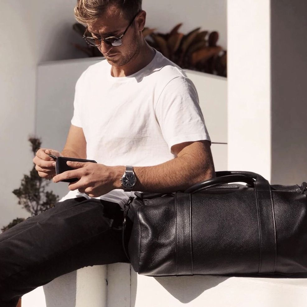 311910825a7d SUCCESSION - black in 2019 | Lu | Leather duffle bag, Bags, Pebbled ...