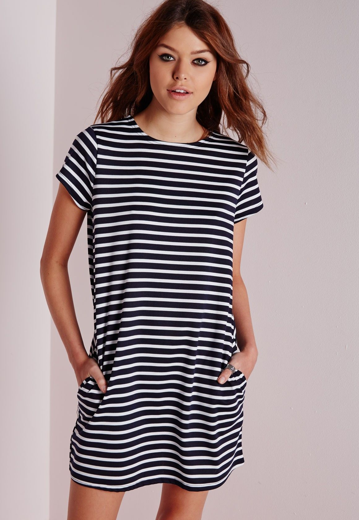 03f67cd2c78e Channel some major day cool vibes this season in this fierce oversized t-shirt  dress. Cause a little chaos in this short sleeved, navy and white striped  ...