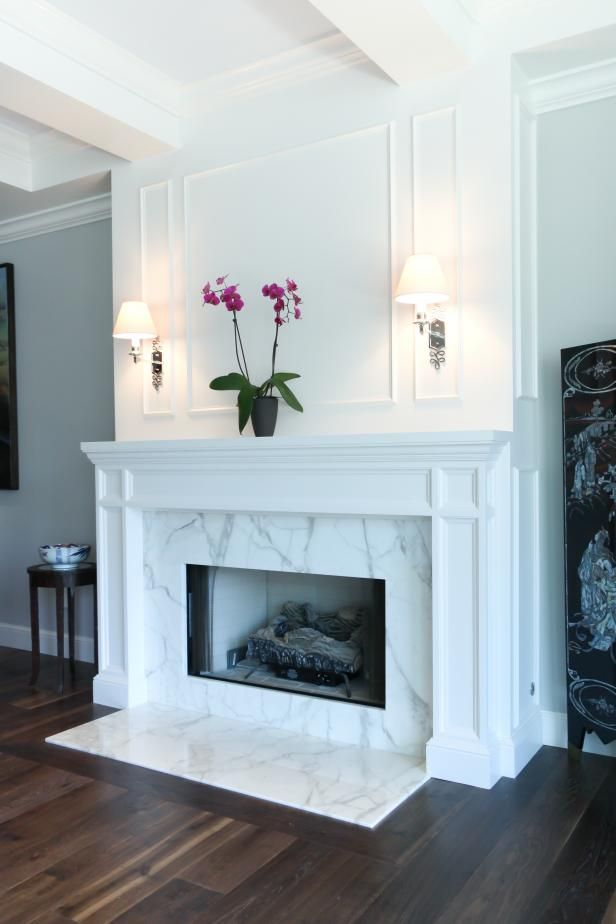 See the striking marble fireplace in this transitional gray living