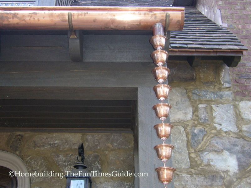 Install A Copper Rain Chain For Simple Elegance On An English Cottage Style Home Rain Chain Copper Rain Chains Gardening Design Diy