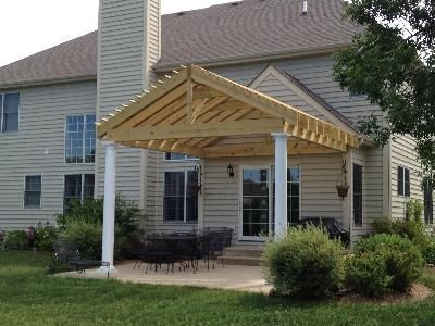 Pergola with a 'gable style' roof, double rafters, and columns to match  home. Custom designed and built by Archadeck of Chicagoland. - Pergola With A 'gable Style' Roof, Double Rafters, And Columns To