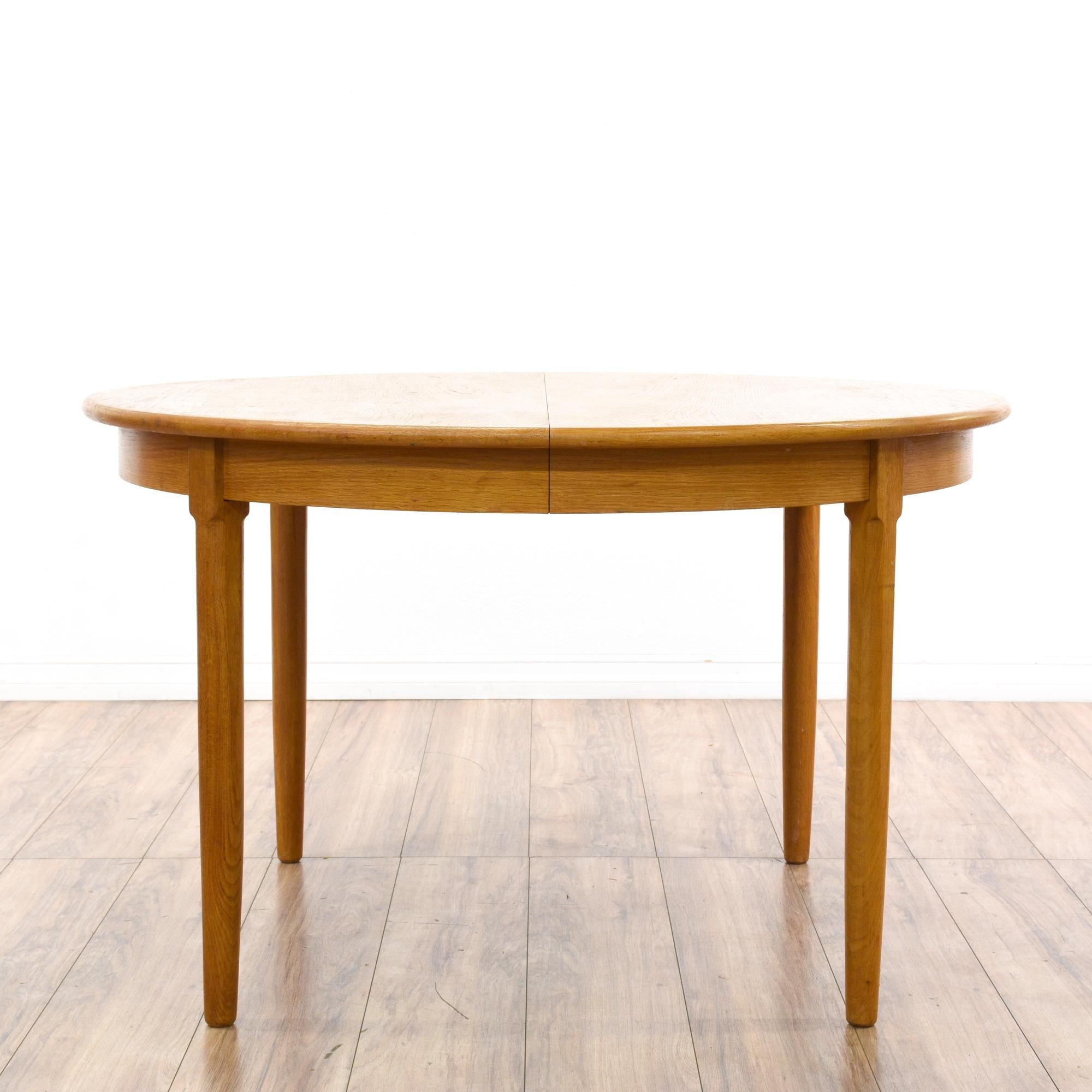 This mid century modern dining table is featured in a solid wood
