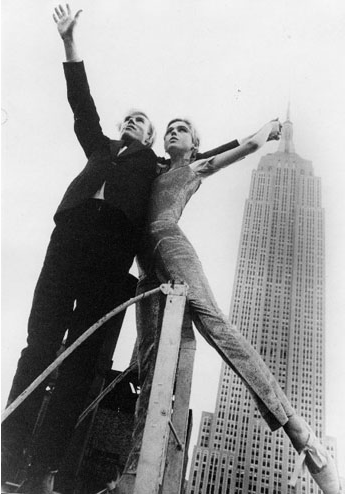 Andy Warhol and Edie in New York. Chrysler building in the background.