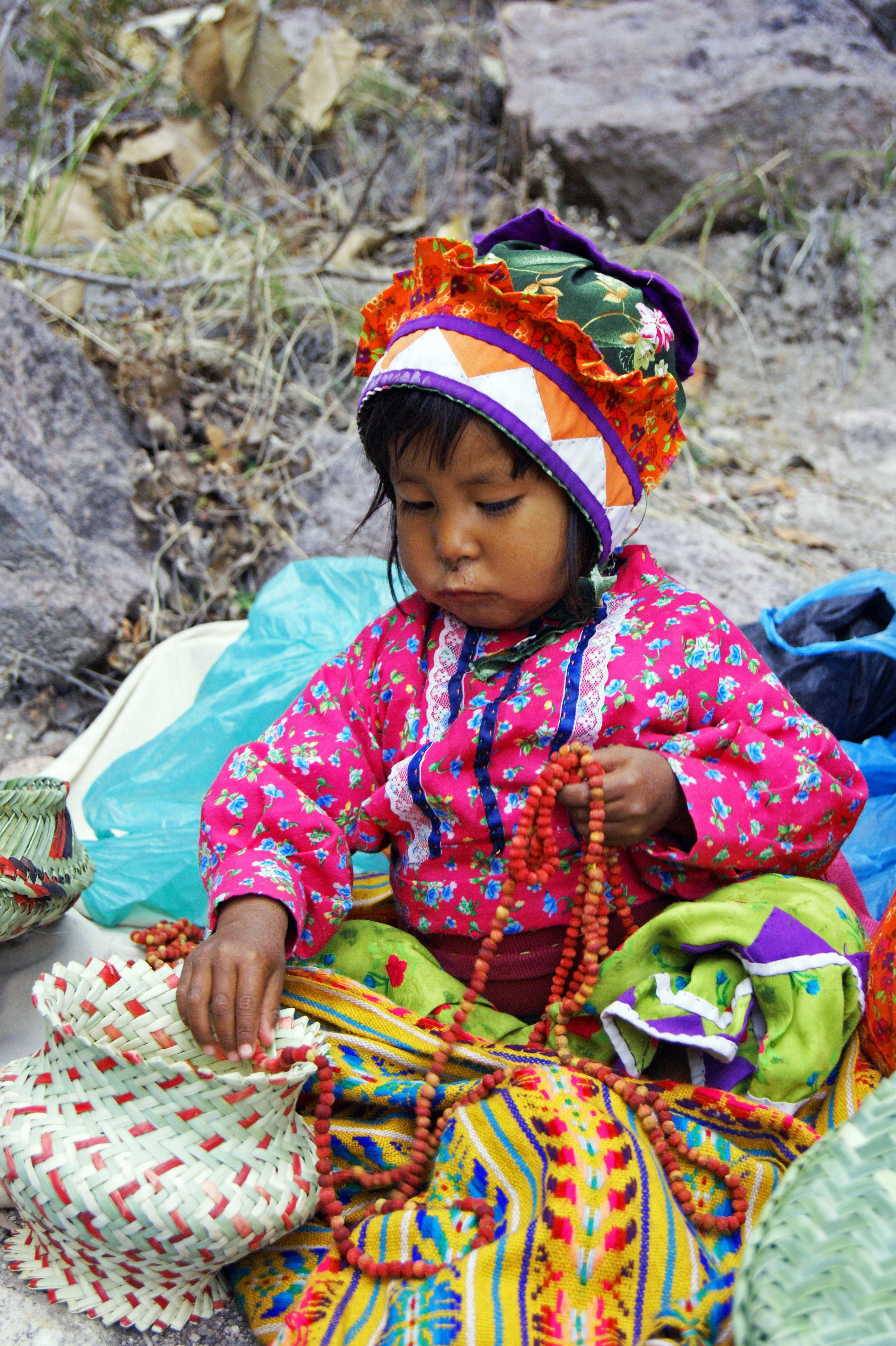 girl carrying yellow and white bags A young Tarahumara girl selling baskets and jewellry in the Copper Canyon I love to learn about other cultures and the Tarahumara cult...