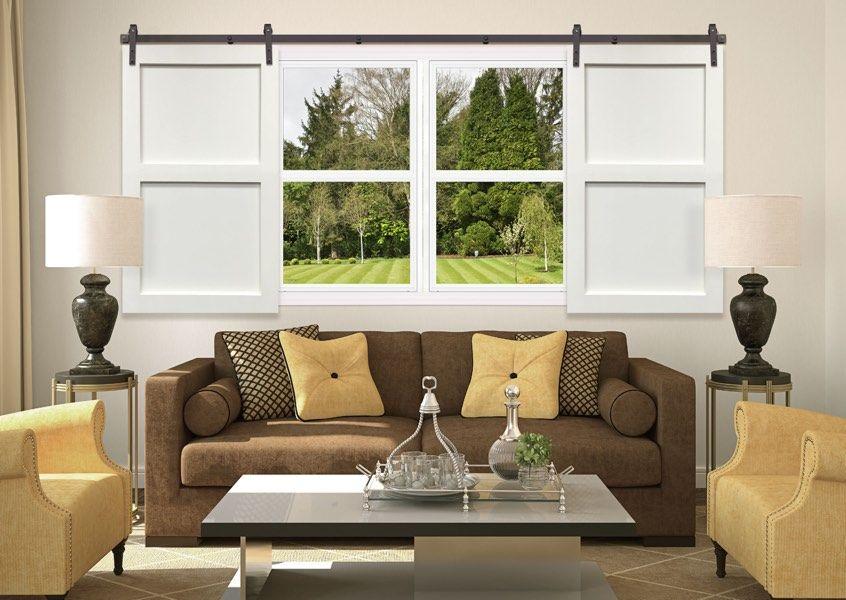 Opened sliding barn door shutters with 2 panels in a for Sliding barn door living room