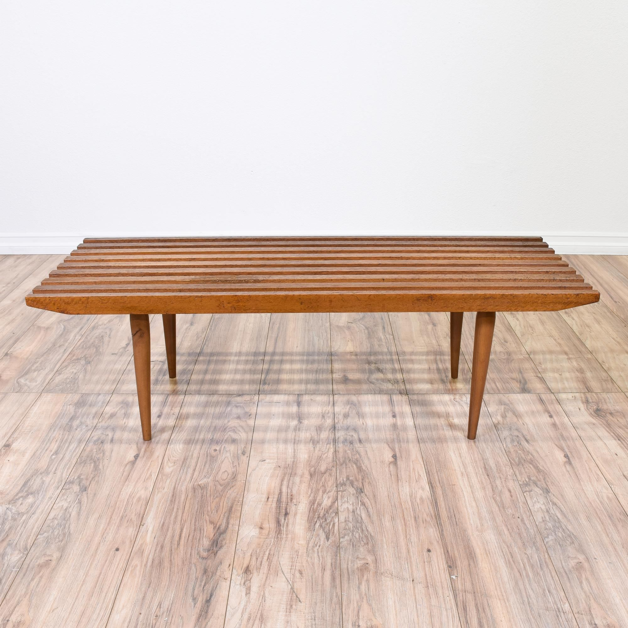 This mid century modern bench made in japan is featured in a solid this mid century modern bench made in japan is featured in a solid wood with a gorgeous teak finish this bench coffee table has tapered legs and a wood geotapseo Gallery