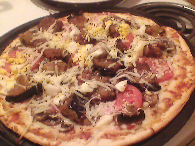 Veggie Pizza , fried eggplant, portabelo mushrooms, fresh tomatos, garlic,hard boiled egg & mozzarella