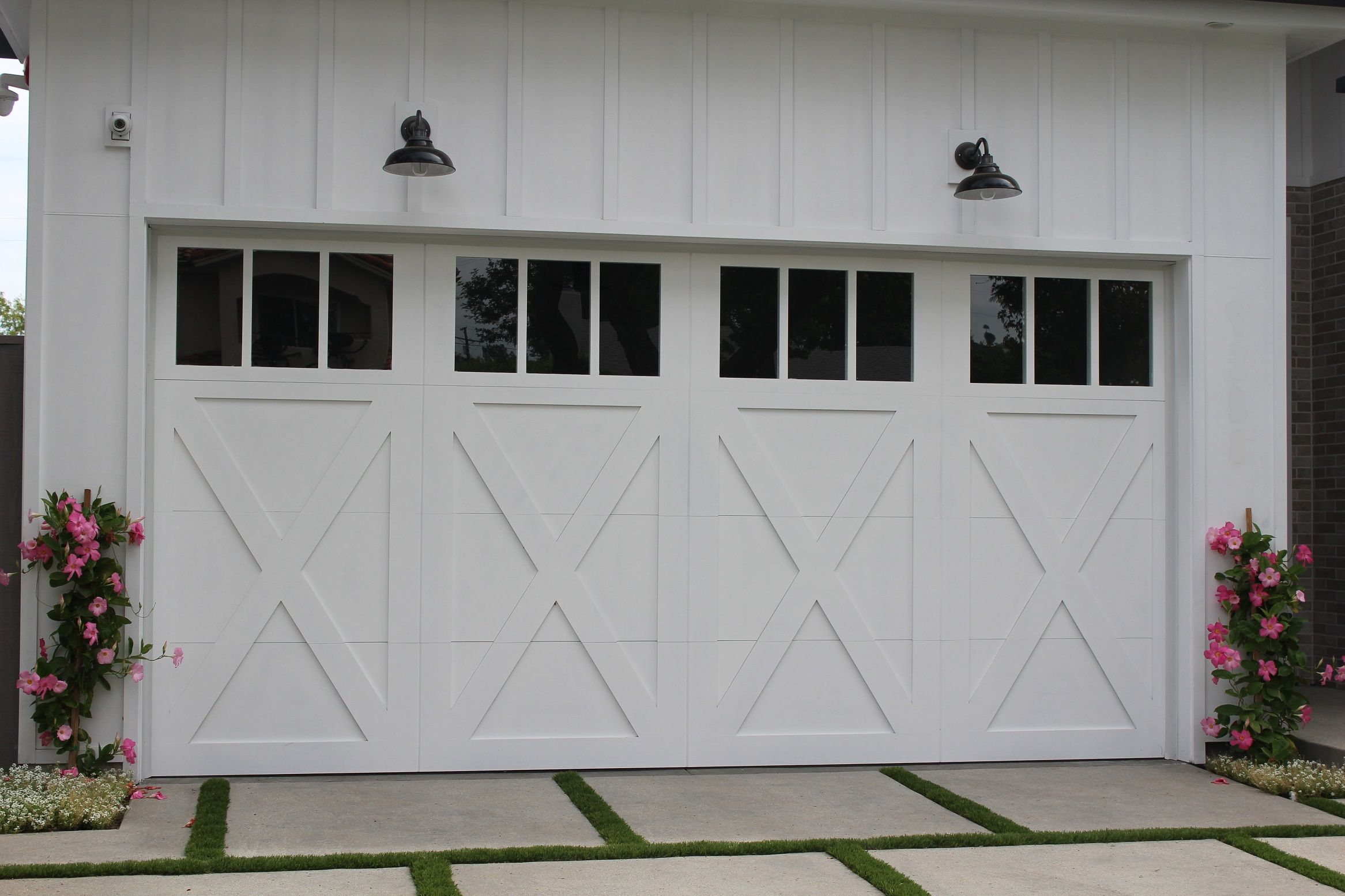 Clopay Coachman Collection Insulated Steel And Composite Carriage House Garage Door Cross Buck Design Wi Carriage Garage Doors Garage Doors Double Garage Door