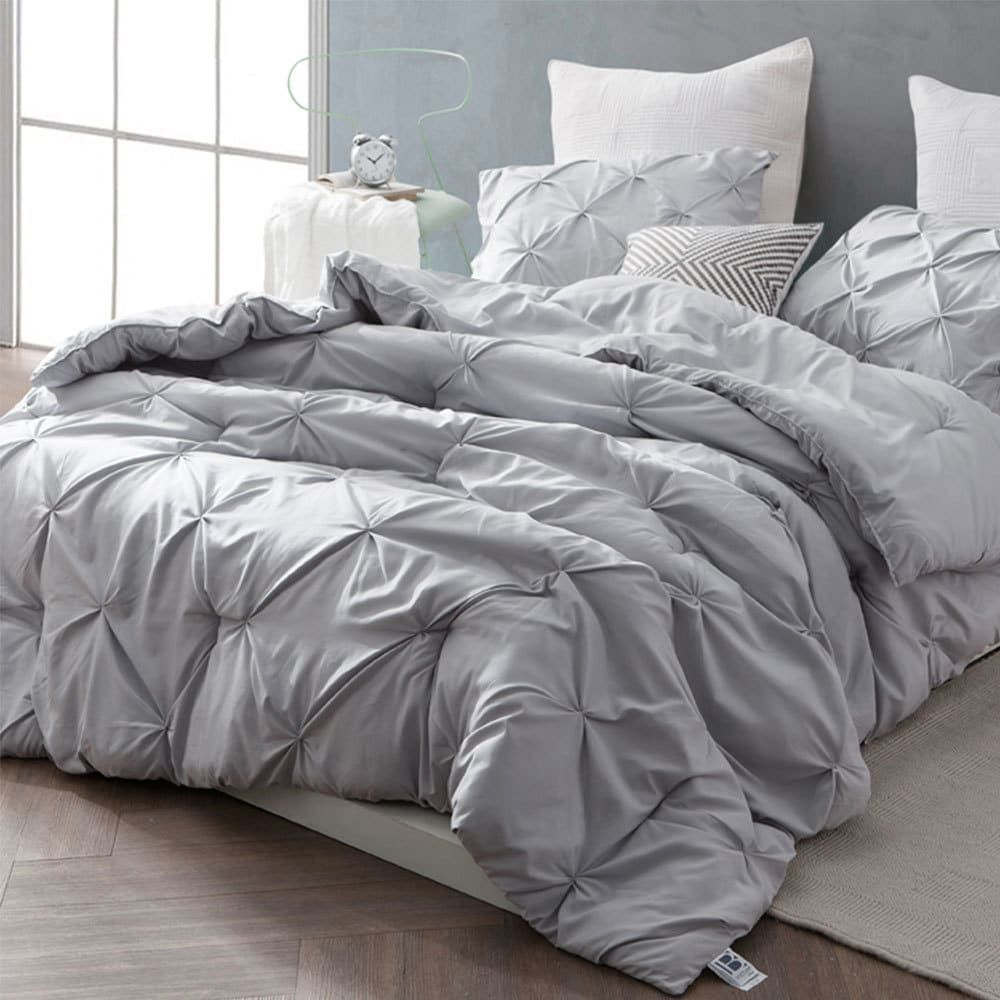 Lay a textured foundation in your master bedroom or guest room with this grey comforter set featuring a pintuck pattern. Made from 100-percent microfiber with 280-GSM thick filling, this set surrounds you in its warmth for peaceful sleep throughout the year. Toss this three-piece set comprising a comforter and two shams in your washer for convenient maintenance. Includes comforter and 2 shams Reverse Pattern: Solid Color Drop Length: 14 Inch Material: Microfiber Style: Classic, Modern, Casual Pa