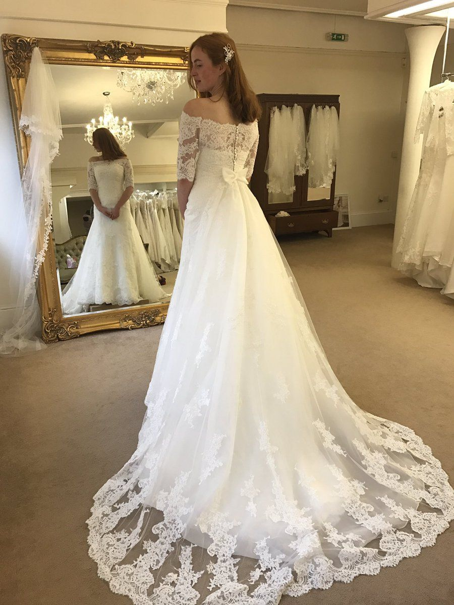 Lace and chiffon wedding dress with long sleeves chapel train from
