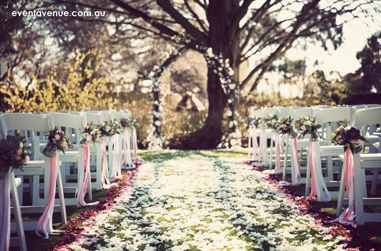 Vintage Wedding Ceremony With Rustic Twig Arch A Carpet Of Petals Pew Jars Garden