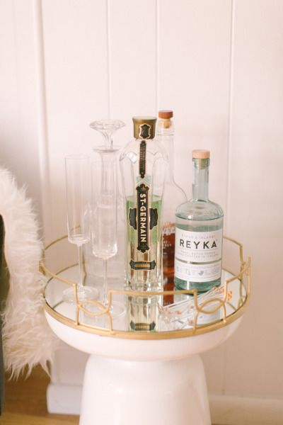 How To Stock A Bar Cart: http://www.stylemepretty.com/living/2014/02/18/how-to-stock-a-bar-cart/