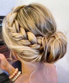 Beautiful messy bun with a side braid. Not sure I have the skill to do even this but I like it! @quidditchallday this could work for bridesmaids? Or even your hair?