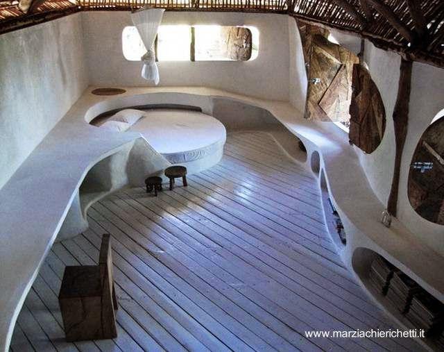 Arquitectura de Casas: Casa orgánica cerca del mar en la selva de África.