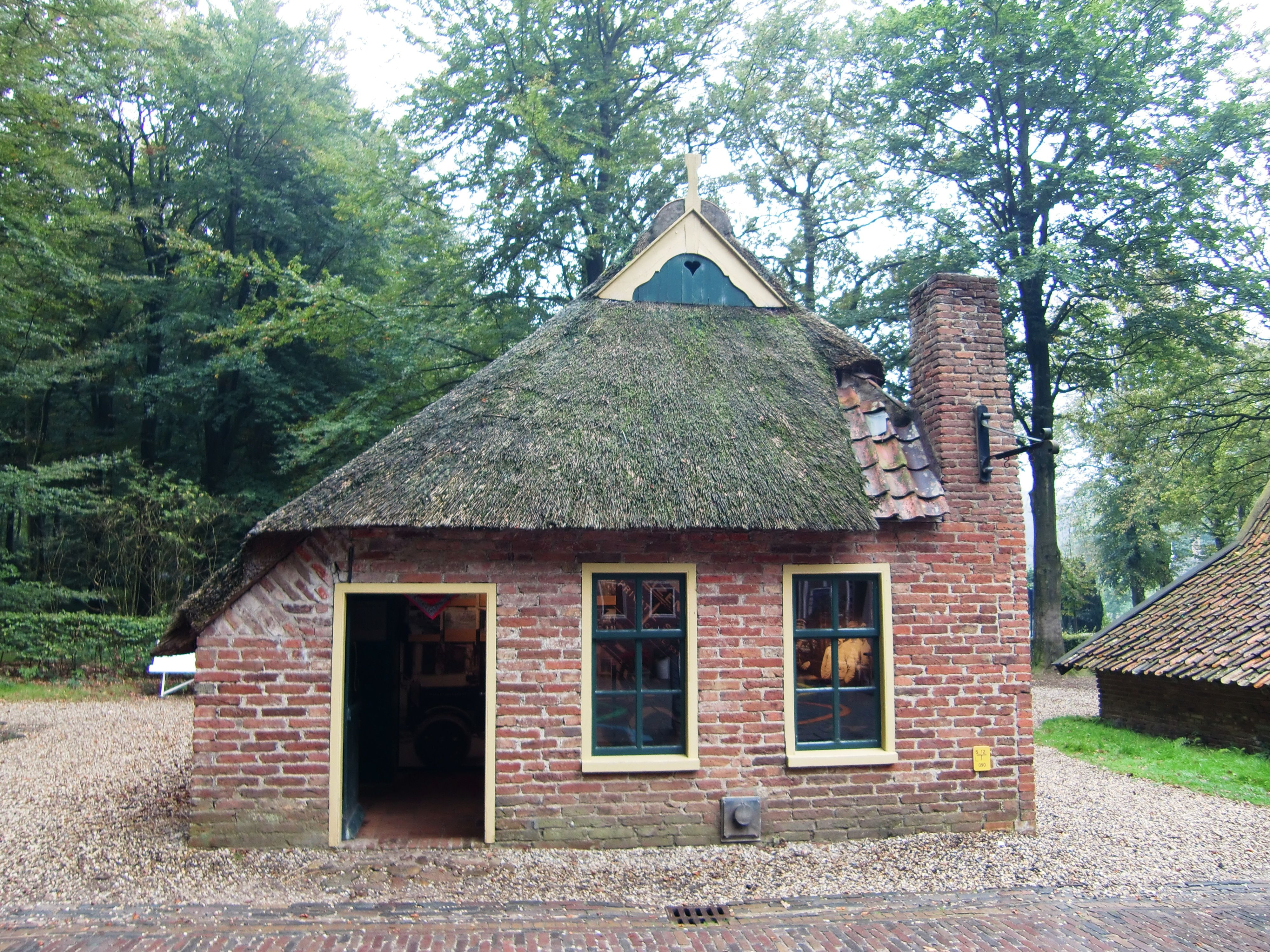 Small Old House Brick With Chimney And Old Style Roofing The