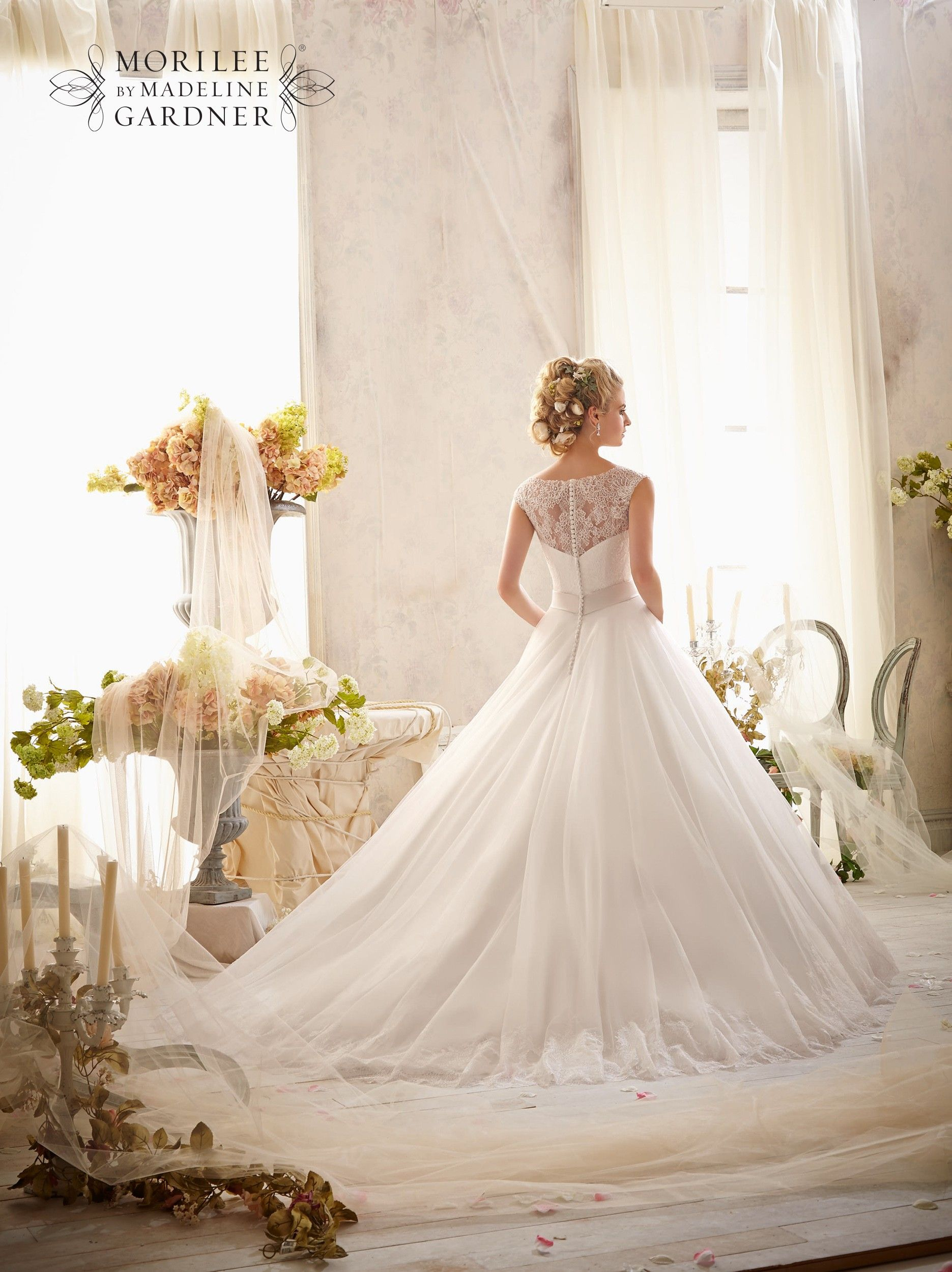Full ballgown wedding dress with waist band and beading detail