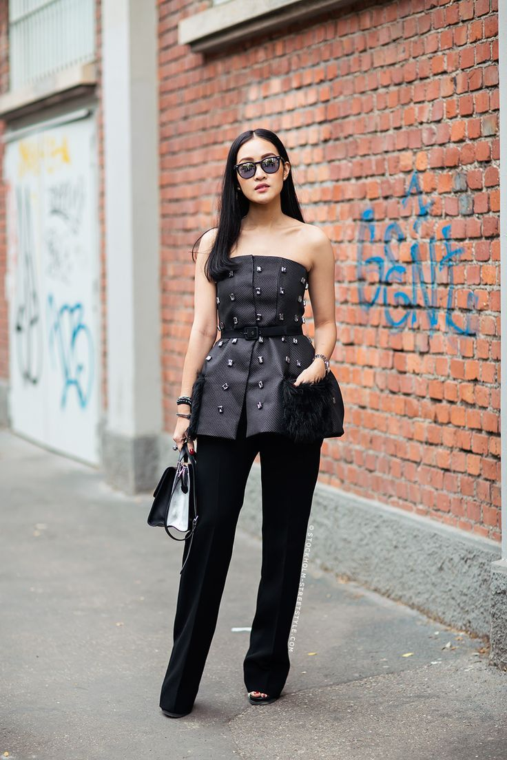 dc0473308f Useful Hacks for Keeping Your Strapless Top in Place – Glam Radar. Joan via  Stockholms Streetstyle. stylish strapless top and black trousers