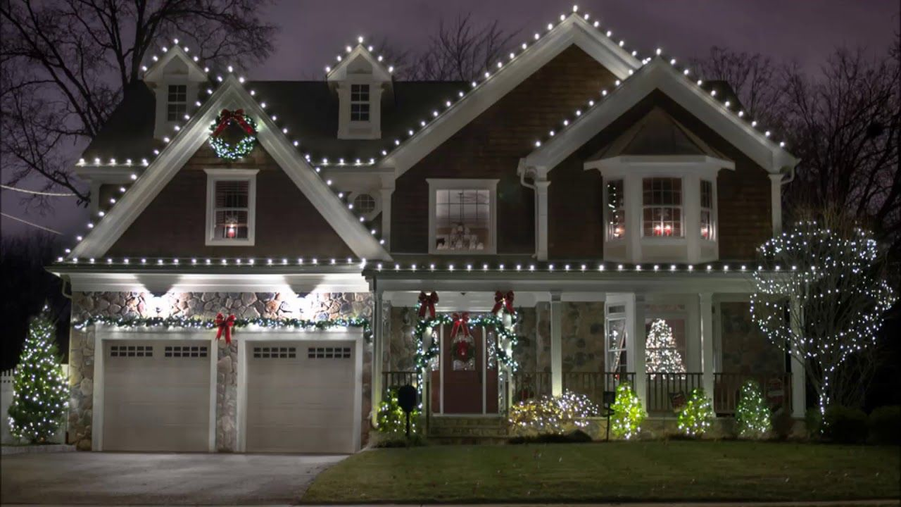 Holiday Light Installer Holiday Light Hanging Service And Cost In Lincol Christmas House Lights Christmas Light Installation Christmas Lights