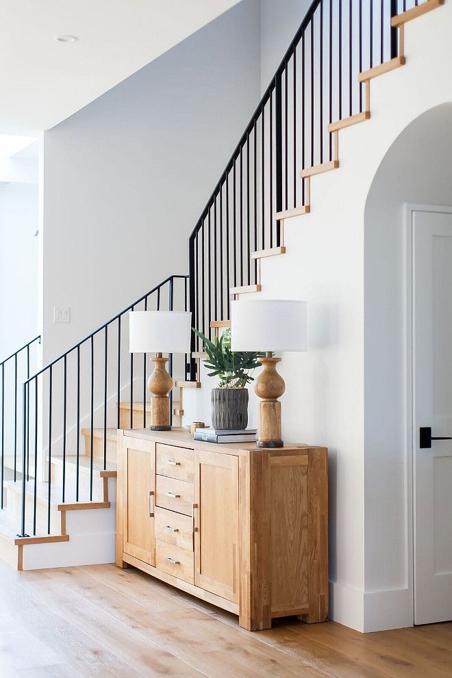 Modern Farmhouse Foyer Features A Custom Staircase With Wrought Iron Stair  Railing   Home Bunch