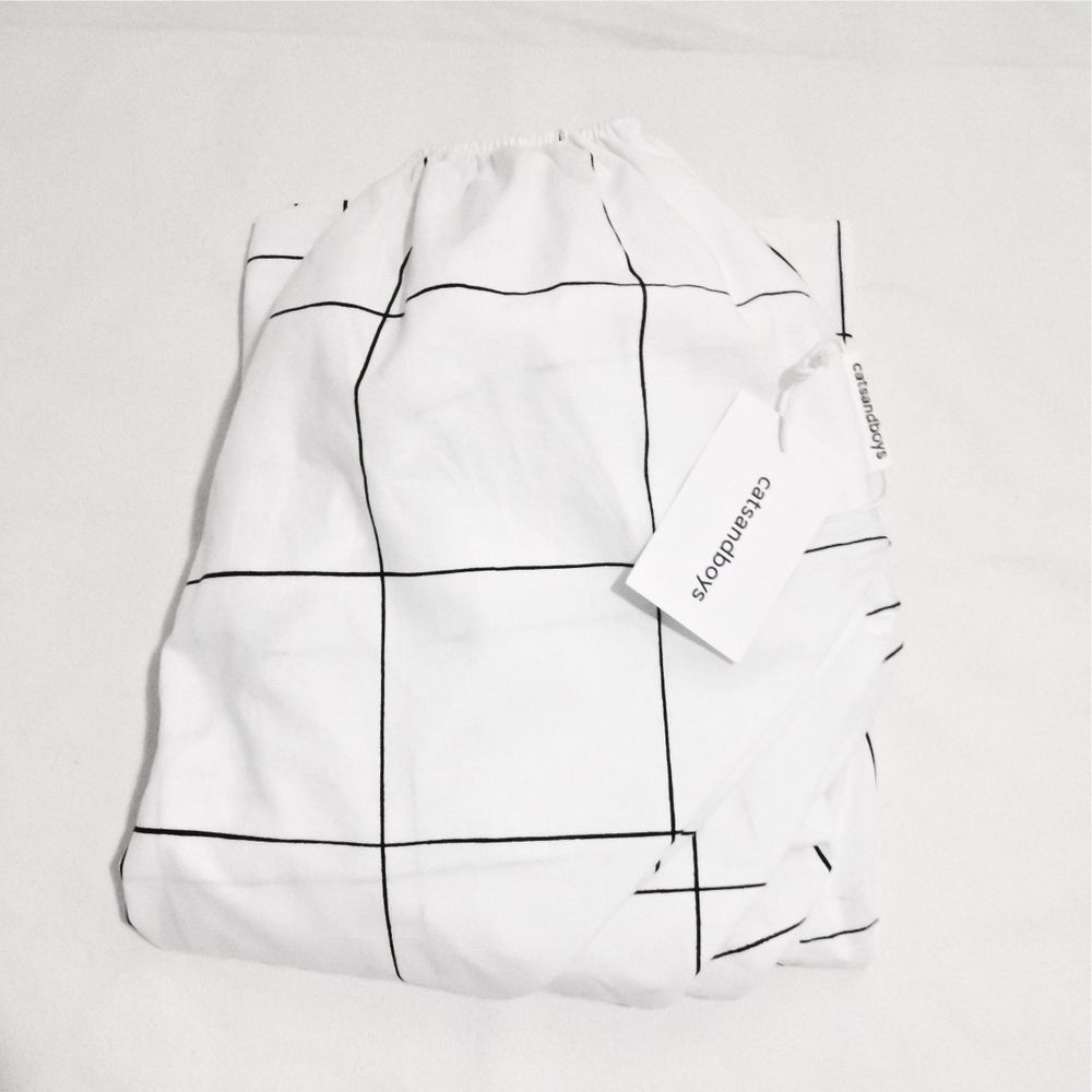 Grid print.100% cotton.Printed with non-toxic paint.Custom geometric shapes are hand printed and are intentionally left imperfect for organic look. There may be slight variations in the design which gives natural charm of handprinted fabric.Special details include a rubber band all over.Cotton may shrink slightly. Wash in cold and hang dry or tumble dryer on low, iron on either side.For sizes in cm please see size chart.