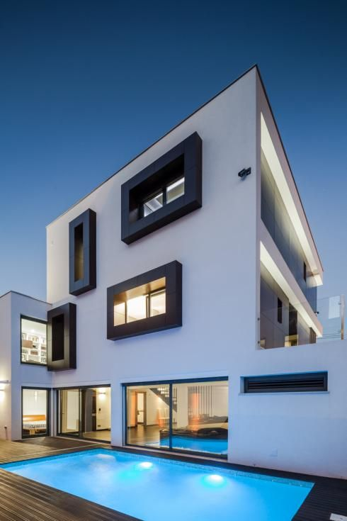 A private home in Portugal with a box body and box windows