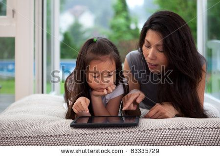 http://www.shutterstock.com/pic-83335729/stock-photo-mother-and-daughter-laying-on-couch-playing-with-a-digital-tablet.html?src=FHlC6Ti-yAtPmROzRyiSdA-2-53