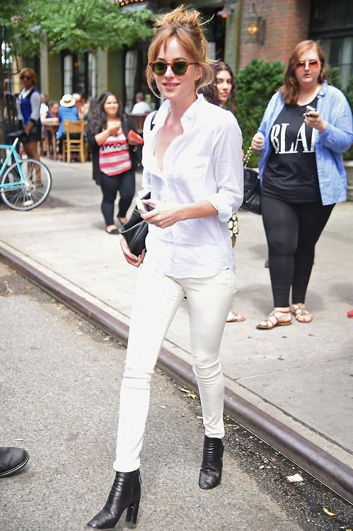 533934faff83 Dakota Johnson in white jeans and Black Boots. Dakota in all white ...