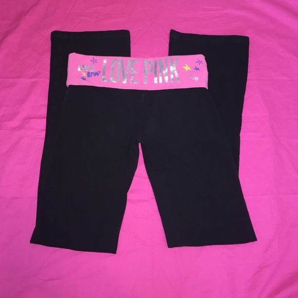 VS black yoga pants Black boot cut yoga pants from Pink by VS the turn down around the waist is pink and has LOVE PINK on the back with design. There is also LOVE PINK in purple on the left front leg with different designs. PINK Victoria's Secret Pants Boot Cut & Flare