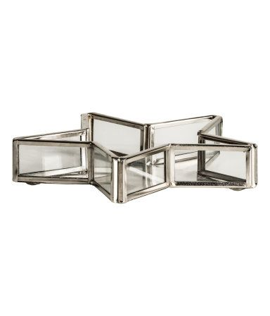 Silver-colored. Small, star-shaped tray in clear glass with a metal ...