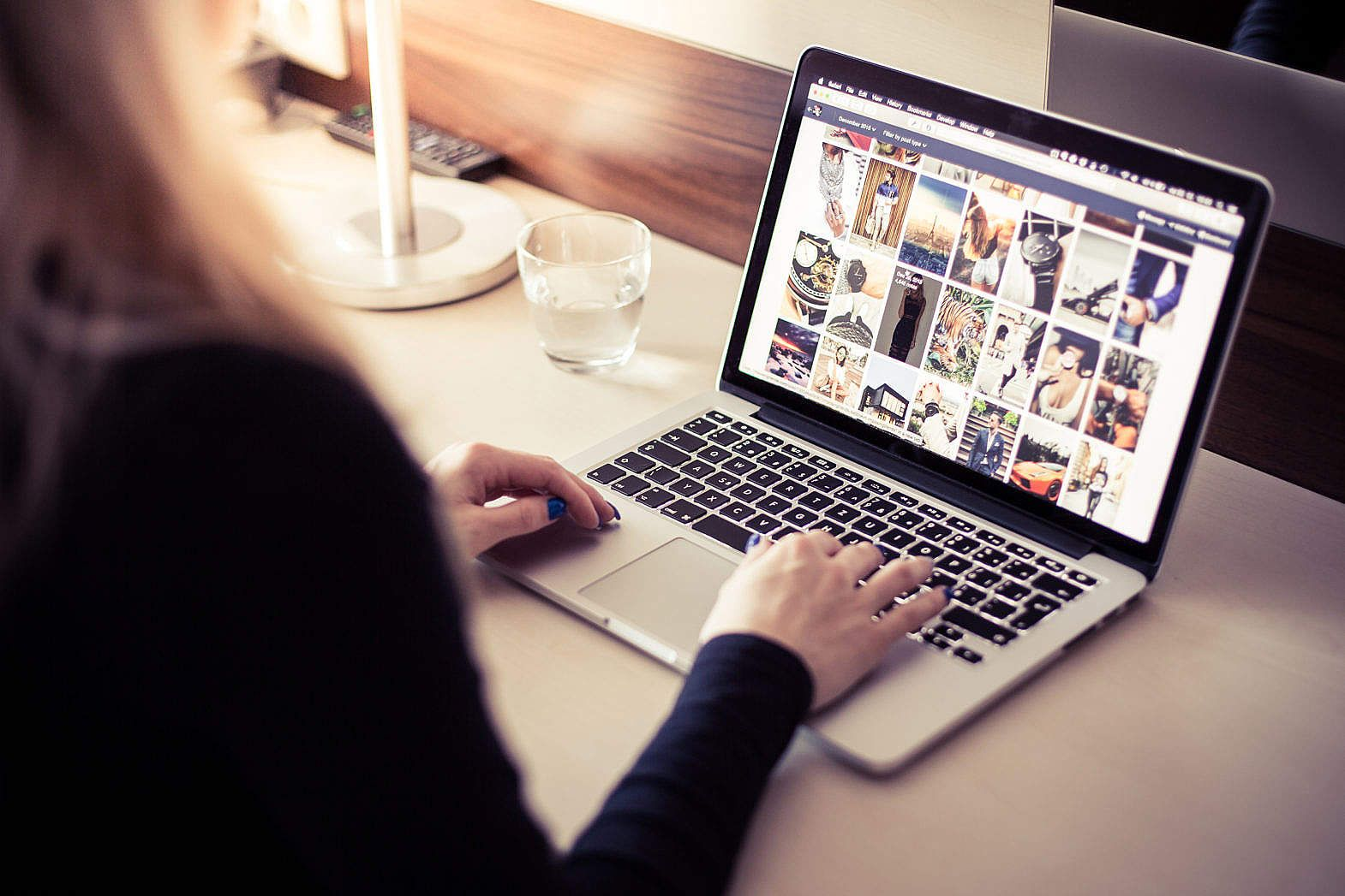 woman browsing tumblr on her laptop free stock photo download