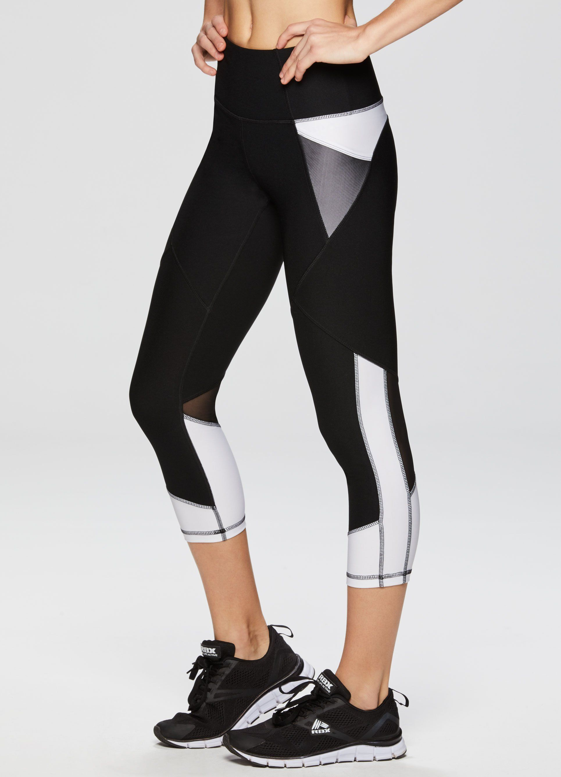 013a83be5a1a7 Step up your fitness routine in this mesh tech pocket color blocked capri  legging. Mesh