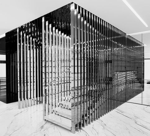 A Central Staircase Surrounded With Vertical Slats Creates A Linear Look At  Saint Laurentu0027s Milan Store