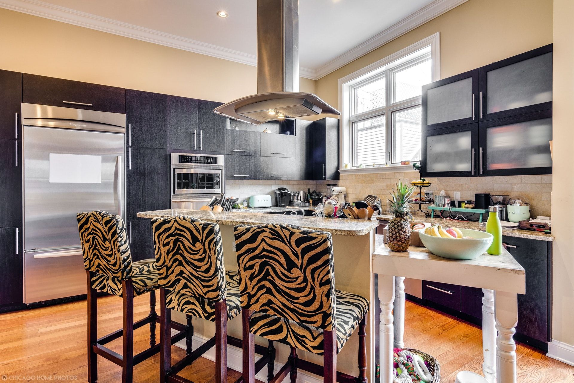 Modern Kitchen With Black Cabinets Frosted Glass Cabinets Stainless Steel Appliances Semi Custom Kitchen Cabinets Recessed Lighting Modern Kitchen Cabinets