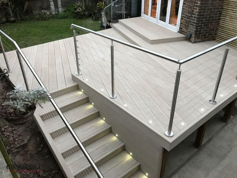 Smoked oak millboard composite decking raised level patio hard